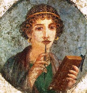 Woman holding wax tablets in the form of the codex. Wall painting from Pompeii, before 79 AD.
