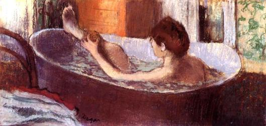 woman-in-a-bath-sponging-her-leg