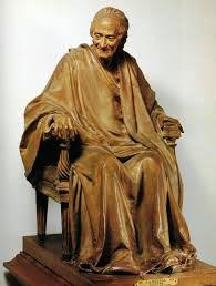 Voltaire seated