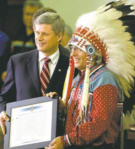 Prime Minister Stephen Harper presents the government's official apology for residential schools to then-Assembly of First Nations Chief Phil Fontaine on June 11, 2008.