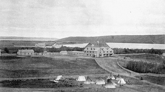 Qu'Appelle Indian Industrial School, Saskatchewan ca. 1885. Parents of First Nations children had to camp outside the gates of the residential schools in order to visit their children.