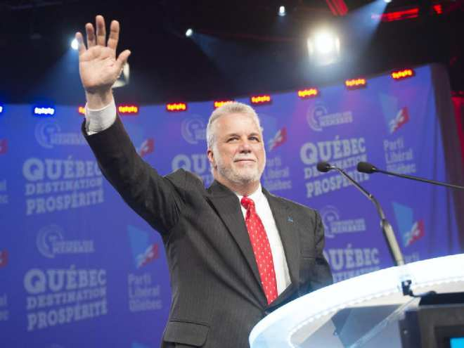quebec-premier-philippe-couillard-waves-to-the-crow-at-the-q