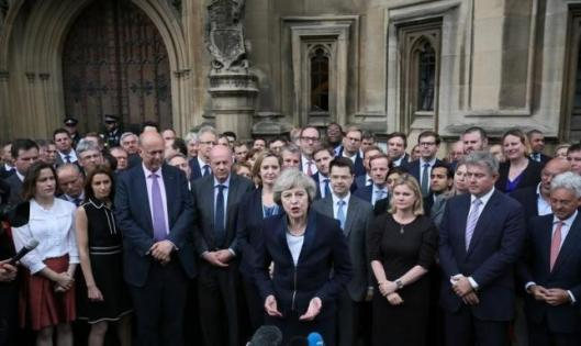 Theresa May speaks to reporters after being confirmed as the leader of the Conservative Party and Britain's next Prime Minister outside the Houses of Parliament in Westminster, central London, July 11, 2016. REUTERS/Neil Hall